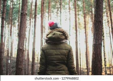 Girl alone in the autumn forest