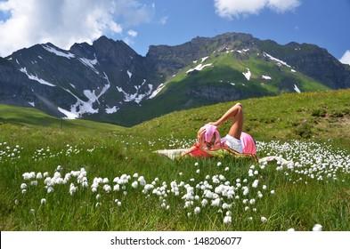 Girl in an Alpine meadow. Melchsee-Frutt, Switzerland