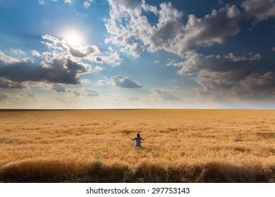 Girl among a field of wheat