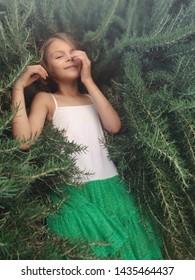 The girl among the green.