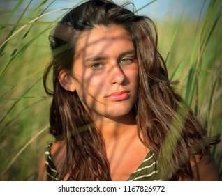 Girl among the tropical vegetation