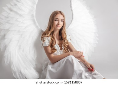 Girl with angel wings in white dress