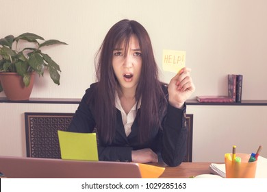 The girl is angry at work. Stress.