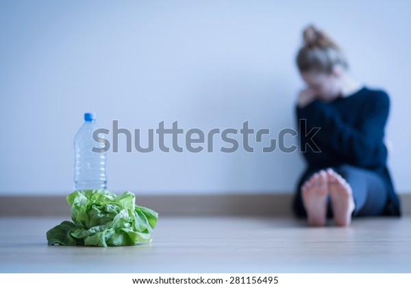 Girl with anorexia being on restricted diet