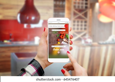 Girl in apartment using modern smartphone for online food order