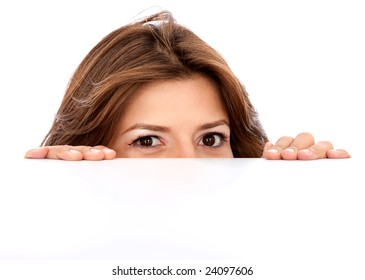 Girl appearing over a cardboard isolated over a white background