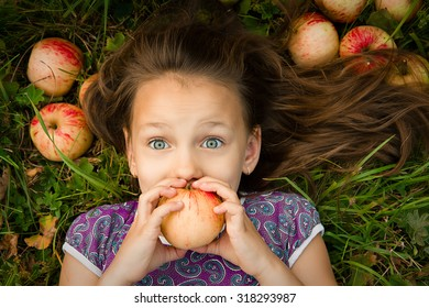 Girl with apples. emotions