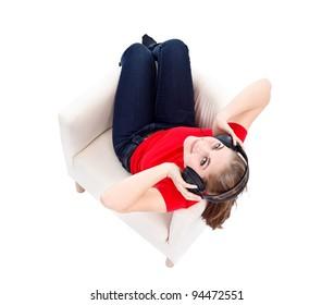 Girl in armchair listening music