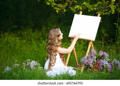 Girl artist with easel