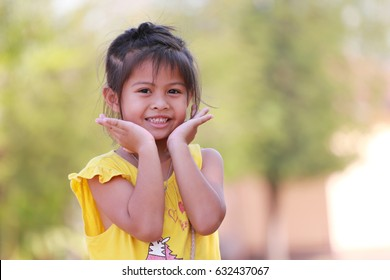 Girl Asian children look at camera in concept of health and growth.
