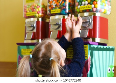 The girl asks the children's act of giving out sweets of chewing gum, marmalade, sweets
