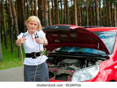 The girl asks for help charge the battery holding cleats