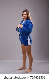 the girl athlete form for sport Sambo. Blue sambo suit