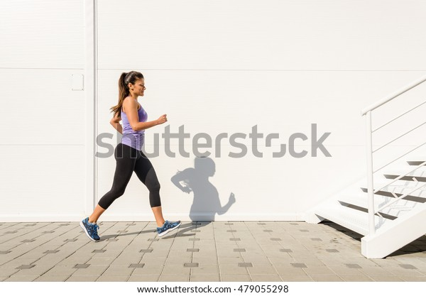 Girl athlete race for the stairs