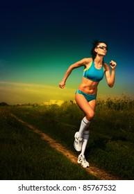 girl athlete runs on road