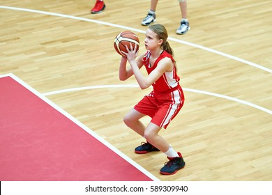 Girl athlete in sport uniform playing basketball