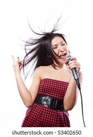 The girl of attractive appearance sings in a microphone, a white background