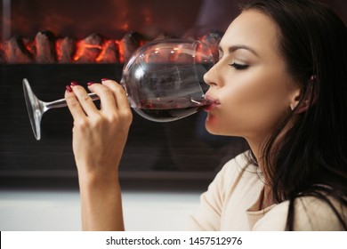 Girl attractive woman makeup face drinking wine wineglass background fireplace background. Luxury wine. Enjoy noble taste french wine. Restaurant and winery. Gorgeous lady drink gourmet wine.
