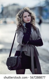 girl in autumn coat and gloves outside winter