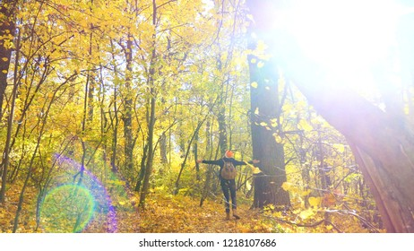 Girl in the autumn forest spends carefree time