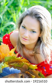 girl with autumn leaf outdoor