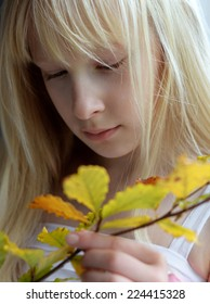 girl and autumn leaves