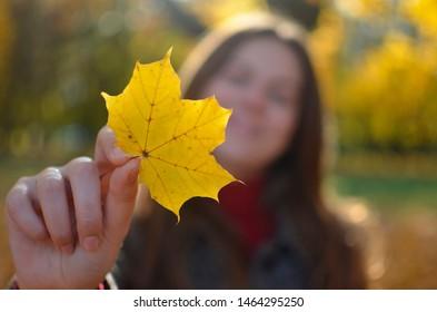 girl in autumn park, happy
