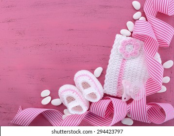 Its a Girl Baby Shower or Nursery background with baby clothes and accessories with copy space for your text here.