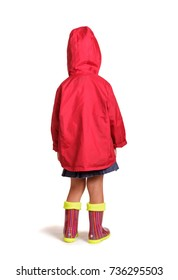 Girl is back in rubber boots and a raincoat isolated on white background
