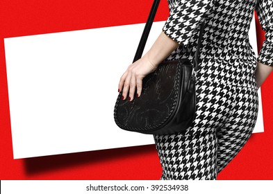 girl with a bag from the back on a  red background . white Banner . businesswoman. back view. blank white piece of paper on a red background. Add your text message easily