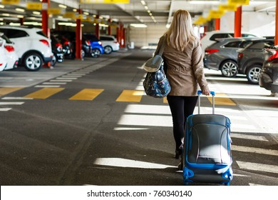 girl with bag in the parking at the airport