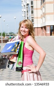 Girl with bags after shopping