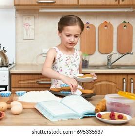 Girl baking cookies. Home kitchen interior. Healthy food concept