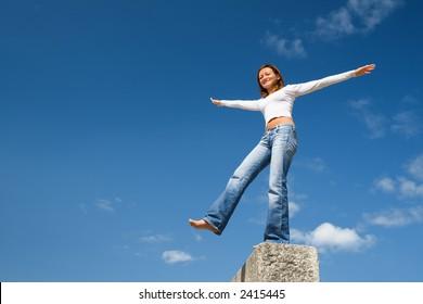 Girl balancing above a precipice