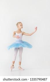 Girl ballerina in a white trick and blue tutu