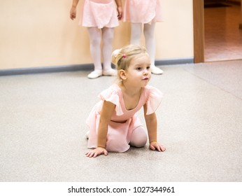 Girl in ballet form young ballerina in class