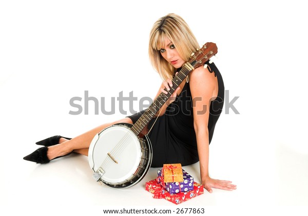 Girl with banjo and presents isolated on white