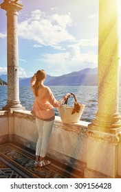 Girl with a basket bag at the Como lake, Italy