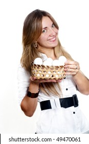 The girl a basket of eggs on light background