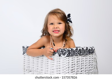 Girl in a basket smiling