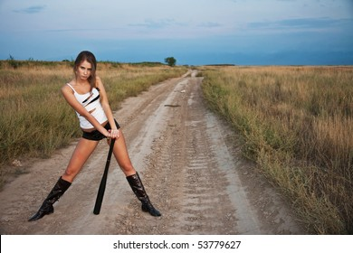 girl with a bat behind shoulders