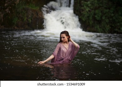 a girl bathes in a river, a girl bathes in a waterfall