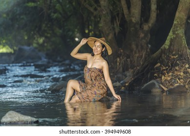 The girl was bathing in the brook,woman washing in the stream,country girl portrait in outdoors,beautiful happy Asian girl smile and laugh together.