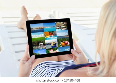 girl in a bathing suit lying on a white chaise lounge with a computer tablet and looking beautiful images of rest