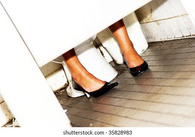 girl in bathroom stall