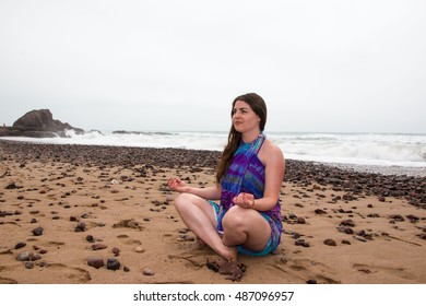 Girl, beach and sea in cloudy and foggy day
