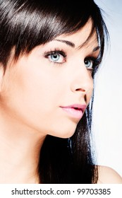 girl with beautiful blue eyes portrait studio shot
