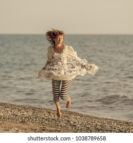 Girl in a beautiful dress by the sea
