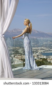 The girl in a beautiful dress with a sea view