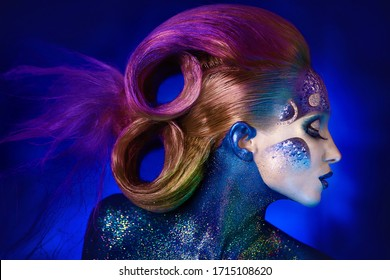 Girl with beautiful golden hair, gold make-up and gold paint, zodiac sign fish